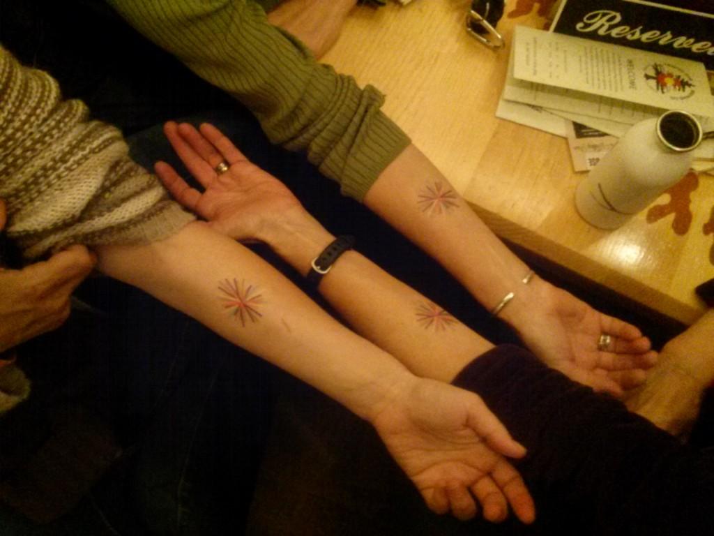 Fringe Artsists flashing their Boulder Arts tattoos