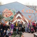 Creative Neighborhoods Public Art Tour Group in front of Jason Garcia's mural