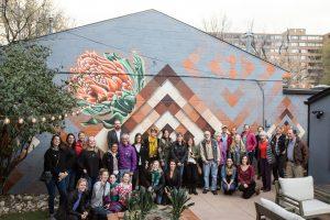 Creative Neighborhoods Public Art Tour Group in front of Tony Garcia's mural