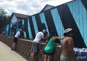 Workshop8 painting a mural for Creative Neighborhoods
